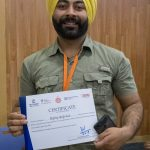 A participant with his certificate